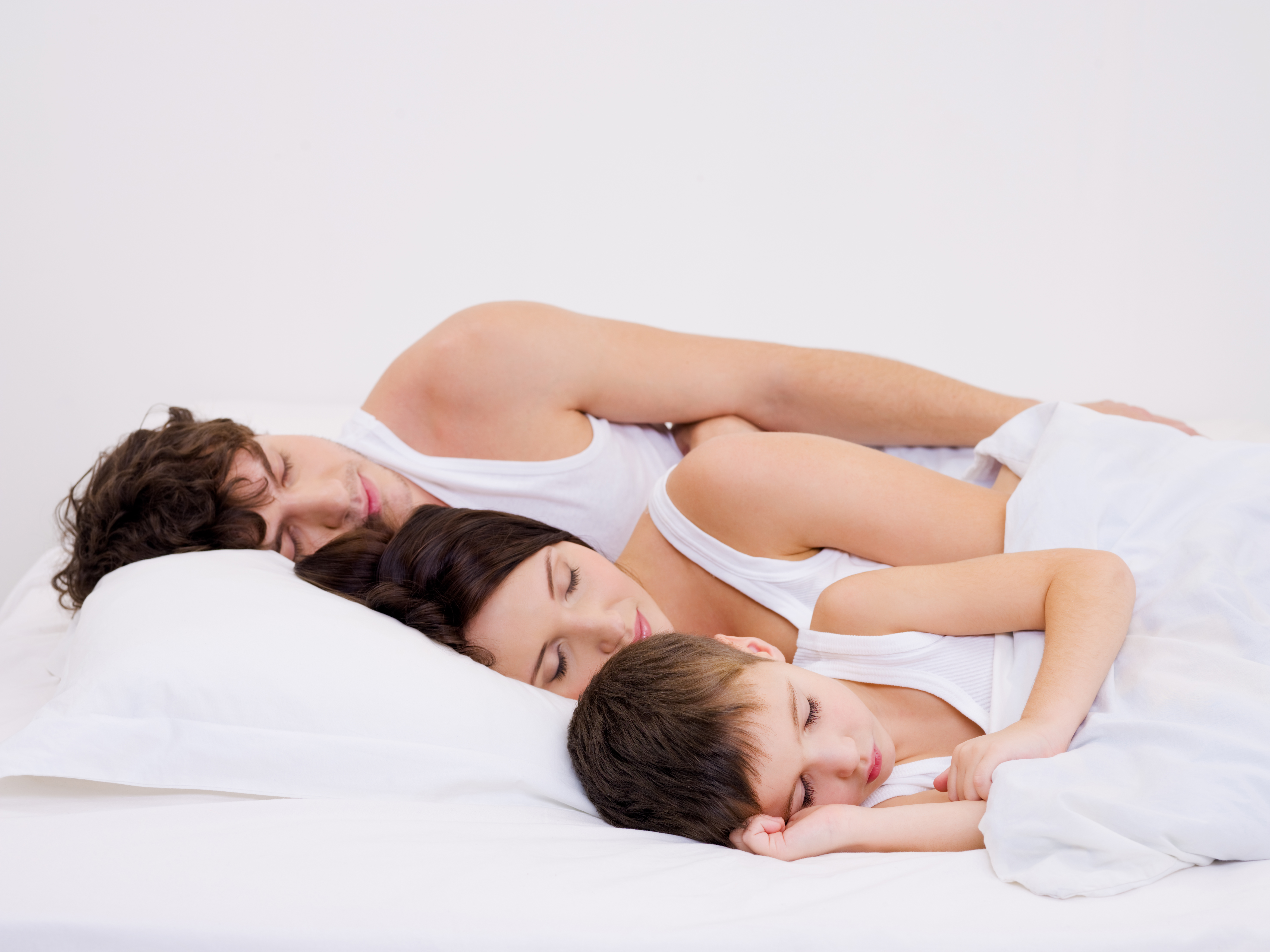 young-beautiful-sleeping-family-with-little-son